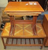 A tiled top coffee table together with a teak nest of three tables