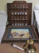 A set of twelve Franklin Mint dancing princesses spoons on a rack together with a Brian Williams
