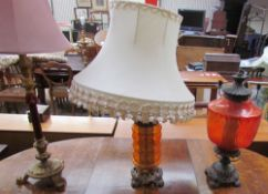 A Victorian upholstered chair together with three table lamps and a candelabra