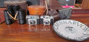 An Ilford Sportsman 35mm camera together with a Kodak Colorsnap 35 camera, Zenith binoculars,