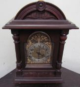 A Kienzle mantle clock, the domed case with a carved cornice and reeded columns,
