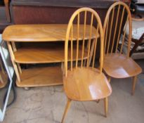An Ercol three tier shelf unit on wheels together with a pair of Ercol dining chairs