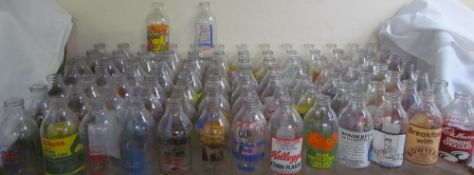 A large collection of advertising milk bottles including Knorr, Intercity, Drinking Chocolate,