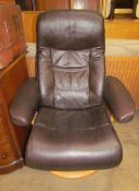 A brown leather reclining armchair