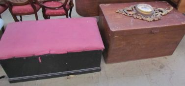 A pine coffer together with another coffer, a wicker table,