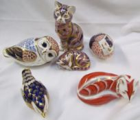 A collection of Royal Crown Derby paperweights including a cat, owl,