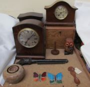An oak mantle clock together with other mantle clocks, toy gun, tobacco box, love spoon,