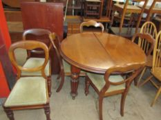 A Victorian mahogany extending dining table on reeded legs,