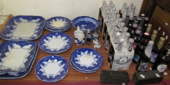 A blue and white part dinner set together with Delft pottery and Ind Coope Strong Lager brewed in