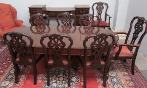 A 20th century mahogany dining suite comprising an extending dining table,