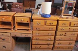 A pair of modern pine chests of drawers together with a pair of pine bedside cabinets, a pine desk,
