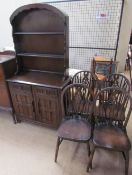 A 20th century Dutch oak dresser together with a set of four wheel back dining chairs
