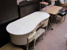 A cream dressing table together with a matching stool and a computer table,