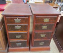 A pair of pedestals each set with four graduated drawers on plinths together with a walnut coffee