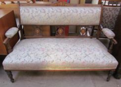 An Edwardian rosewood two seater settee, the back with floral inlay,