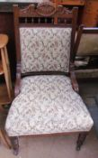 A Edwardian upholstered ladies chair with turned legs and casters together with a tiled top coffee