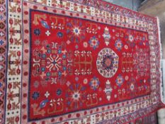 A red ground rug,