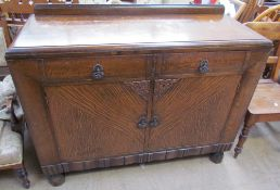 A 20th century oak sideboard with two drawers and two cupboards