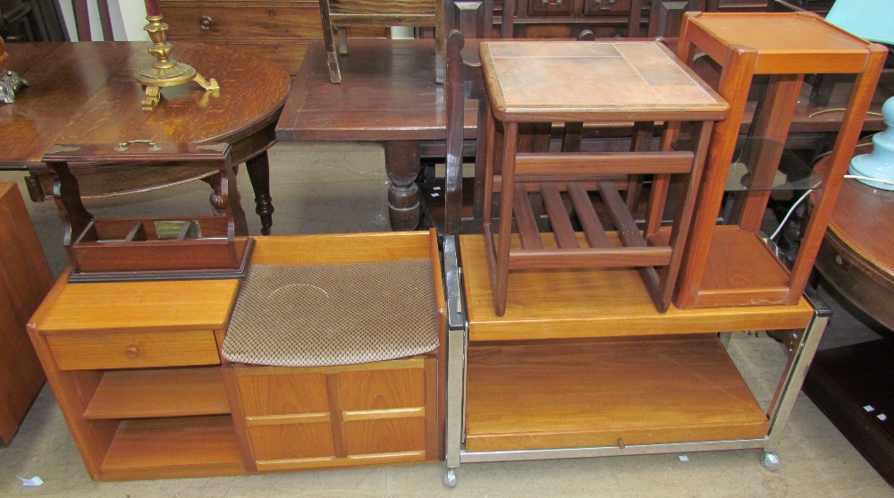 Lot 31 - A Nathan teak telephone table together with a tantalus stand, a tiled top coffee table,