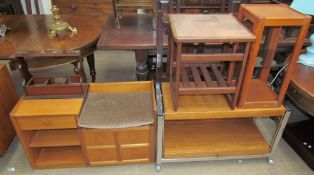 A Nathan teak telephone table together with a tantalus stand, a tiled top coffee table,