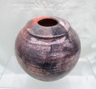 A studio pottery vase in pinks and greys, indistinctly signed,