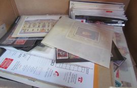 A large collection of world stamps, cigarette cards,