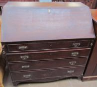 A George III mahogany bureau, the sloping fall enclosing a fitted interior of pigeon holes and