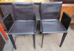 A pair of Italian leather dining chairs by Quia on tapering legs