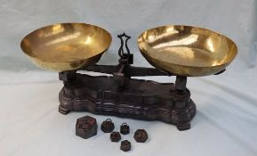 A pair of French brass and cast iron scales, with dished pans, the shaped base cast ''F10K''