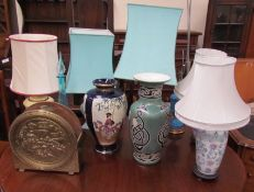 Six assorted table lamps together with two pottery vases and a glass bottle with stopper