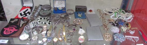 A rolled gold bangle together with assorted costume jewellery, rings, cigarette cases, necklaces,