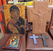 A plaster crucifix together with two other crucifixes and two icons