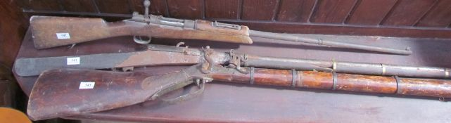 A continental flintlock rifle together with two other rifles