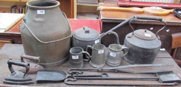 A cast iron kettle together with a saucepan and lid, fire irons, flat irons, pewter mugs, bronze pot