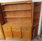 A 20th century ash dresser with a planked back above three short drawers and three cupboards on a