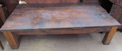 A coffee table with a planked top and square legs, utilising old timbers