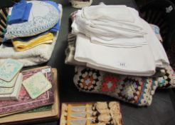 A collection of table linen, blankets, coasters, table mats etc