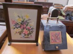 An Arts and Crafts coal box decorated with a song bird together with a woolwork fire screen