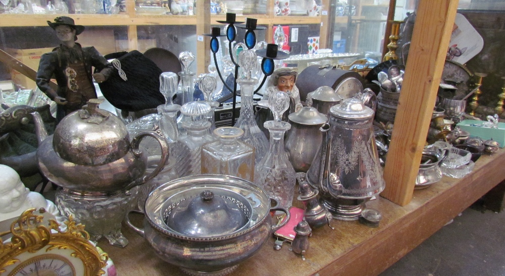 Lot 342 - Large brass candlestick together with pottery buddhas, glass decanters, mantle clock, assorted