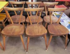 A set of six Ercol elm seated stacking dining chairs, Patent No. 845,582, Reg. Design No. 884892