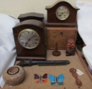 An oak mantle clock together with other mantle clocks, toy gun, tobacco box, love spoon, stained