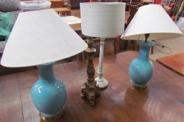 A pair of turquoise pottery baluster table lamps together with three other table lamps
