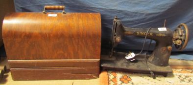A singer sewing machine, cased together with another Singer sewing machine