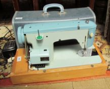 A Brother electric sewing machine, cased