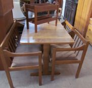 A 20th century modern kitchen dining table, bench and two chairs together with a teak magazine rack