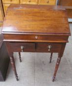 A 19th century mahogany bureau, with a sloping fall above two drawers on turned tapering legs