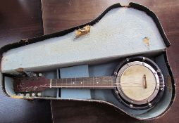 An eight string banjo / mandolin, with case
