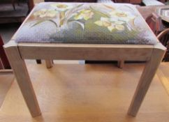 A dressing table stool, the pad seat embroidered with daffodils by Angela Dewar embroidery