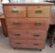 A 19th century padouk two section campaign chest with two short and three long drawers on turned