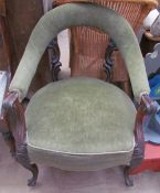A Victorian rosewood library chair with a bowed upholstered back and arms, with an upholstered